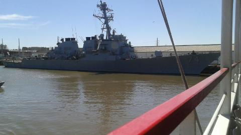 One of the many industrial, freight, and military ships that line the Savannah River.