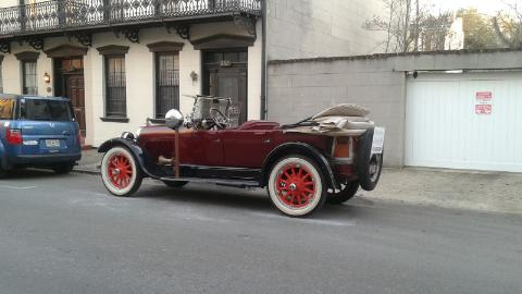 Vintage Vehicle On The Street By The City Square.